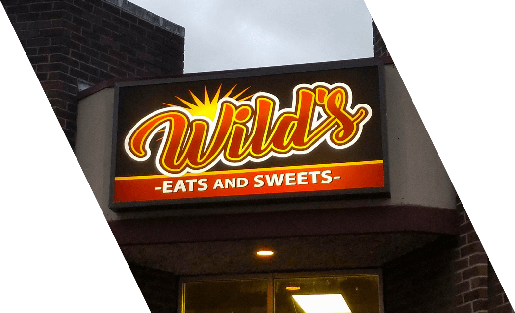 Wilds Eats and Sweets Sign